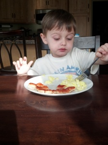 Luke eating one of his healthier meals; eggs and toast